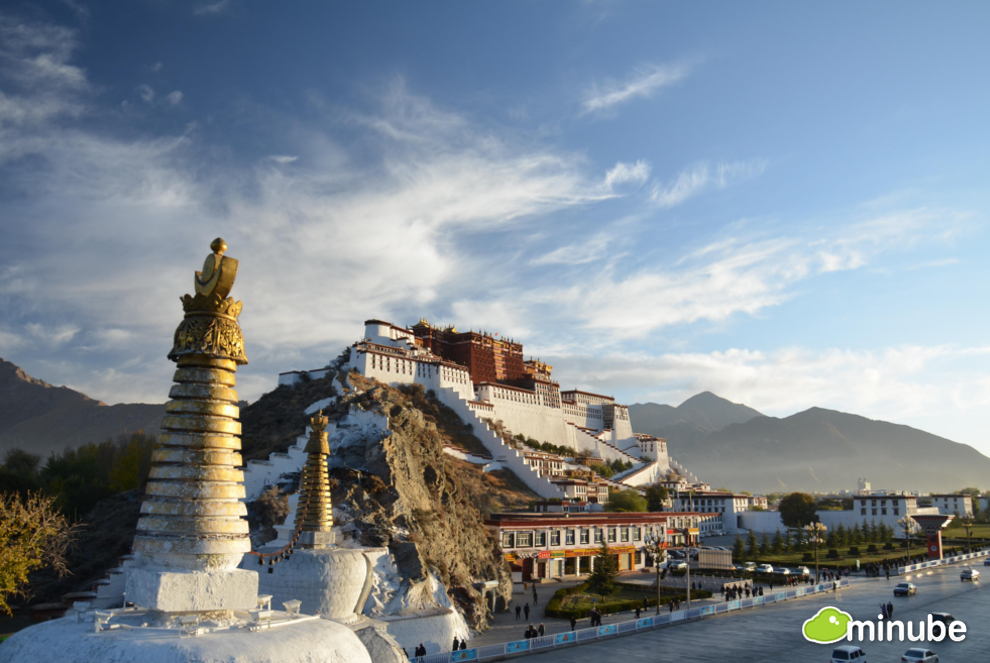 Lhasa is the spiritual center of Tibetan Buddhism and the rugged Himalayas set against Lhasa's incense-filled monasteries and palaces make for one of the most unforgettable views on Earth. (Photo by Juanjo Fontanet)